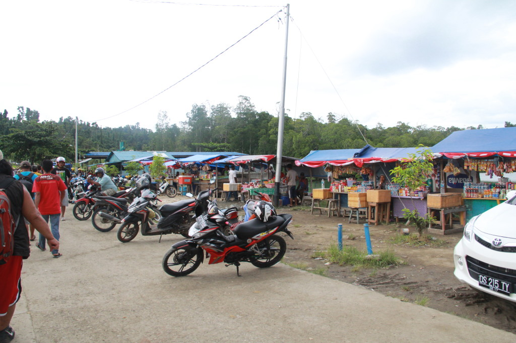 "Food stalls with ""Ojek"" taxis waiting in front"